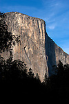 "El Capitan, Yosemite National Park. El Capitan is one of the most spectacular granite monoliths in the world.  Climbers from around the world flock to Yosemite Valley every year for a chance to climb this grand spectacle.  The most famous climbing route on El Capitan is ""The Nose"".  The route ascends the prow on the sun/shade line to the right of the Heart.  The prominent Heart appears as if was carved into the rock but is a natural formation on El Capitan. This photograph was taken at sunrise."