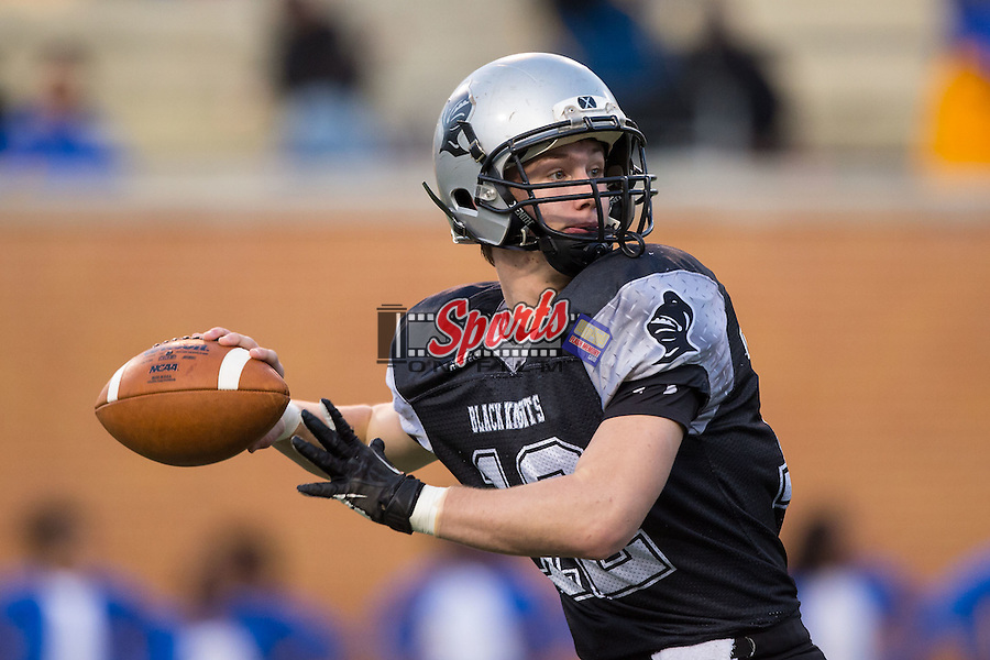 Colton Millsaps (12) of the Robbinsville Black Knights drops back to pass during first half action against the Plymouth Vikings in the NCHSAA 1A State Championship at BB&T Field on December 12, 2015 in Winston-Salem, North Carolina.  The Vikings defeated the Black Knights 28-20.  (Brian Westerholt/Sports On Film)