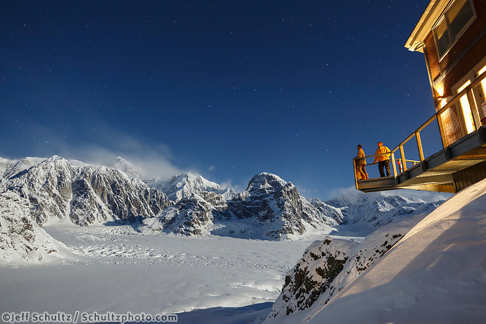 People view Winter landscape of Denali and the Alaska Range at night with stars from the deck of the Sheldon Chalet.  Ruth Glacier and Amphitheater in the Alaska Range.  Winter 2017<br /> <br /> Photo by Jeff Schultz/SchultzPhoto.com  (C) 2017  ALL RIGHTS RESERVED