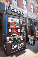 Signage in front of a Beyond Vape vaporium in New York on Monday, September 7, 2015. (© Richard B. Levine)
