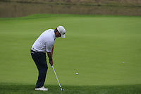George Coetzee (RSA) chips onto the 18th green during Saturay's Round 3 of the 2014 BMW Masters held at Lake Malaren, Shanghai, China. 1st November 2014.<br /> Picture: Eoin Clarke www.golffile.ie
