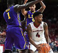 NWA Democrat-Gazette/J.T. WAMPLER Arkansas' Daryl Macon looks for help as Louisiana State's Duop Reath (1) and Daryl Edwards apply pressure Wednesday Jan. 10, 2018 at Bud Walton Arena in Fayetteville. Arkansas lost 75-54.
