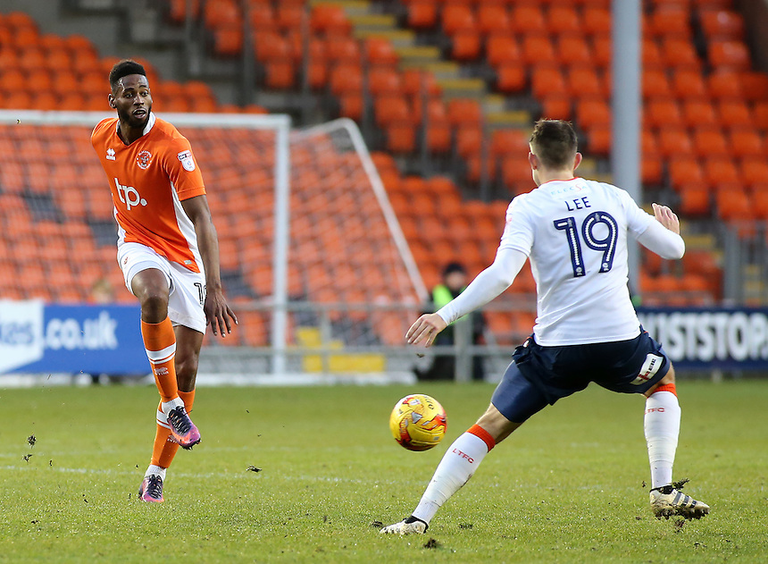 Blackpool's Jamille Matt plays the ball round Luton Town's Oliver Lee<br /> <br /> Photographer David Shipman/CameraSport<br /> <br /> The EFL Sky Bet League Two - Blackpool v Luton Town - Saturday 17th December 2016 - Bloomfield Road - Blackpool<br /> <br /> World Copyright &copy; 2016 CameraSport. All rights reserved. 43 Linden Ave. Countesthorpe. Leicester. England. LE8 5PG - Tel: +44 (0) 116 277 4147 - admin@camerasport.com - www.camerasport.com