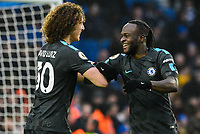 Victor Moses of Chelsea (15) Celebrates scoring his sides fourth goal  with David Luiz of Chelsea (30)   during the Premier League match between Brighton and Hove Albion and Chelsea at the American Express Community Stadium, Brighton and Hove, England on 20 January 2018. Photo by Edward Thomas / PRiME Media Images.