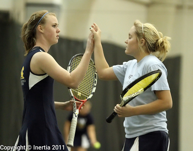SIOUX FALLS, SD - MAY 1: Augustana's Katie Jesperson, left, gives teammate Brittany Gaster a high five during their doubles match against Nebraska-Kearney Sunday afternoon at Sioux Empire Fitness in Sioux Falls. (Photo by Dave Eggen/Inertia)