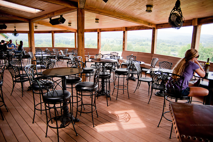 The deck outside Chateau O'Brien Winery and Vineyard provides spacious, comfortable seating and fabulous views of the surrounding vineyards and foothills of the Blue Ridge.