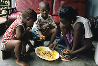 Children eating rice