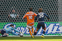 Houston Dynamo goalkeeper (18) Pat Onstad makes a save on a shot by New England Revolution forward (20) Taylor Twellman. The Houston Dynamo defeated the New England Revolution 2-1 in the finals of the MLS Cup at RFK Memorial Stadium in Washington, D. C., on November 18, 2007.