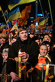 "Kiev, Ukraine.December 27, 2004..Perhaps the last ""Orange Revolution"" rally in Kiev as election polls show him in a strong lead with 98% of the vote counted. ..Supporters of the opposition candidate Viktor Yushchenko rally to support him on Maidan Independence Square.  ..The first round of voting was considered fraudulent when the ruling president Viktor Yahukovich won and the opposition candidate Viktor Yushchenko lost. ..Several hundred thousand Ukrainians took to the streets of Kiev and held daily rallies on Maidan Independence Square. The protests lasted nearly a month before the first vote was declared invalid and a new round of elections held on December 26, 2004. ..The demonstrations would come to be known as the ""Orange Revolution"" after the color of the opposition party."