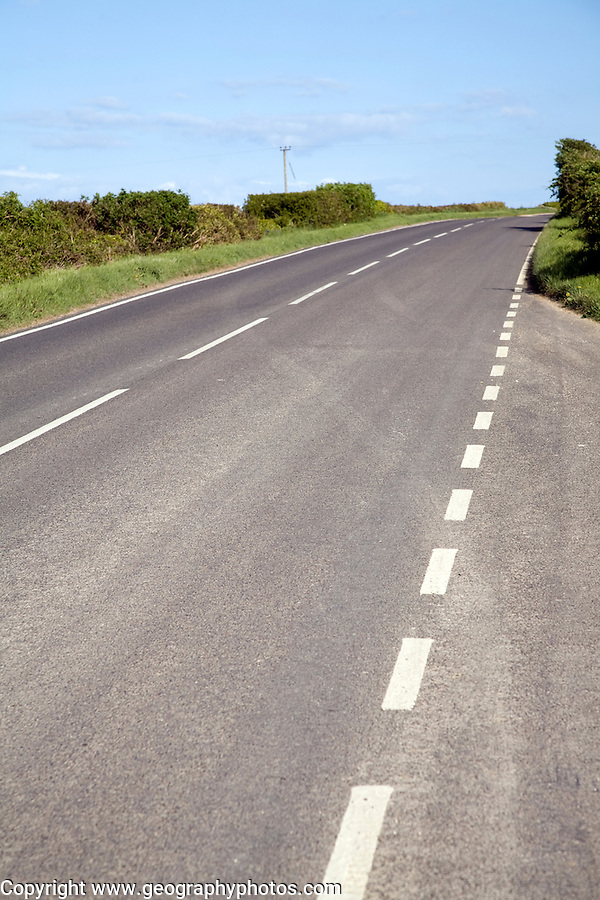 Empty main road with white lines