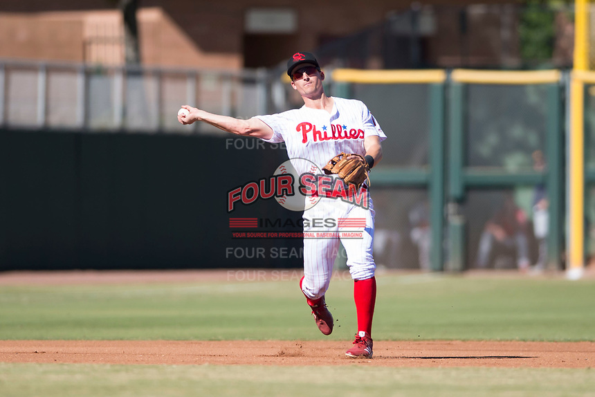 Scottsdale Scorpions third baseman Luke Williams (15), of the Philadelphia Phillies organization, throws to first base during an Arizona Fall League game against the Mesa Solar Sox at Scottsdale Stadium on November 2, 2018 in Scottsdale, Arizona. The shortened seven-inning game ended in a 1-1 tie. (Zachary Lucy/Four Seam Images)