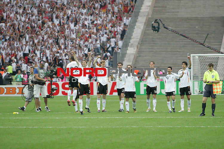 FIFA WM 2006 - Quarter-finals / Viertelfinale<br /> Play #57 (30-Jun) - Germany vs Argentina.<br /> David Odonkor, Arne Friedrich, Per Mertesacker, Christoph Metzelder, Torsten Frings, Tim Borowski, Oliver Neuville and Michael Ballack (l-r) from Germany celebrate the 5-3 victory after penalty after the match of the World Cup in Berlin with the fans / supporters.<br /> Foto &copy; nordphoto