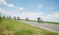 front of the peloton stearing into a highspeed corner<br /> <br /> 2014 Belgium Tour<br /> (final) stage 5: Oreye - Oreye (179km)