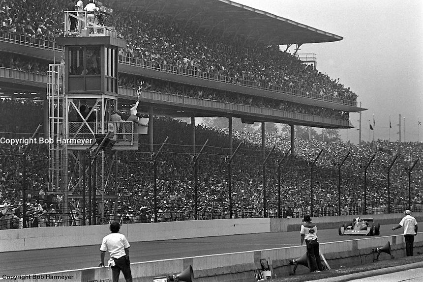 AJ Foyt takes the checkered flag to win the 1977 Indianapolis 500 auto race.