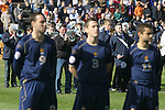 Three Scotland players standing to attention as the Faroese band plays the national anthems before the Euro 2008 group B qualifying match at the Svangaskard stadium in Toftir between the Faroe Islands and Scotland. The visitors won the match by 2 goals to nil to stay in contention for a place at the European football championships which were to be held in Switzerland and Austria in the Summer of 2008. It was the first time Scotland had won in the Faroes, the previous two matches ended in draws.