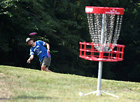 NWA Democrat-Gazette/J.T. WAMPLER Collier Dallas of Fayetteville putts Wednesday July 31, 2019 at Cedar Creek Disc Golf Course in rural Washington County near West Fork. For information about the course visit www.cedarcreekdgc.com/