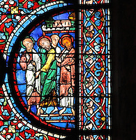 Four apostles to the right of the scene of 2 thurifers or incense-bearer angels swinging censers, pointing down to the funeral procession of Mary, from the Glorification of the Virgin stained glass window, in the nave of Chartres Cathedral, Eure-et-Loir, France. This window depicts the end of the Virgin's life on earth, her dormition and assumption, as told in the apocryphal text the Golden Legend of 1260. Chartres cathedral was built 1194-1250 and is a fine example of Gothic architecture. Most of its windows date from 1205-40 although a few earlier 12th century examples are also intact. It was declared a UNESCO World Heritage Site in 1979. Picture by Manuel Cohen