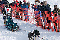 Musher # 57 Tim Osmar at the Restart of the 2009 Iditarod in Willow Alaska