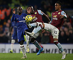 Chelsea's N'Golo Kante is challenged by Aston Villa's Marvelous Nakamba (C) and Ezri Konsa during the Premier League match at Stamford Bridge, London. Picture date: 4th December 2019. Picture credit should read: Paul Terry/Sportimage