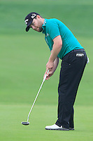 Branden Grace (RSA) putts on the 17th green during Saturay's Round 3 of the 2014 BMW Masters held at Lake Malaren, Shanghai, China. 1st November 2014.<br /> Picture: Eoin Clarke www.golffile.ie