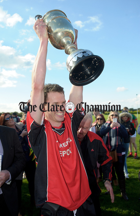 Meelick  captain Kevin Harnett lifts  the cup following the win over Kilmurry Ibrickane in their Junior A  county final at Gurteen. Photograph by John Kelly.