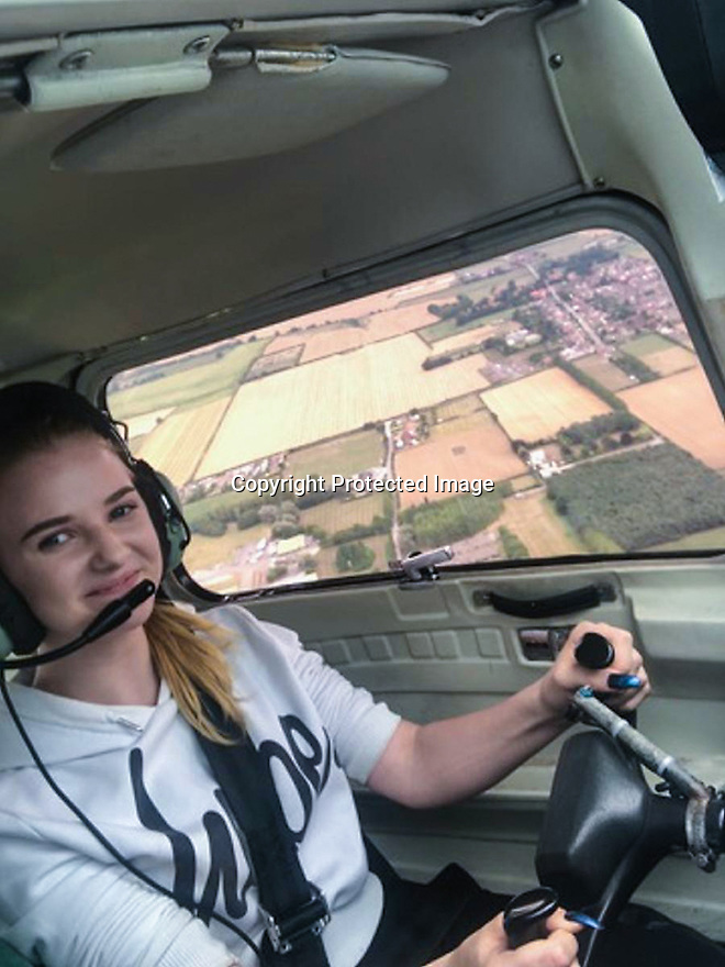 "15/08/18<br /> <br /> ***Video:   https://youtu.be/XDNa_lycFgw ****<br /> <br /> Amy Boulton at the controls before hitting the balloon.<br /> <br /> A fourteen-year-old girl on her first ever flying lesson had the fright of her life when the plane hit a gas-filled balloon yesterday. <br /> Amy Boulton screamed as the Cessna 152 collided with a bright pink balloon shaped as the number 2 as it flew at 1000 ft above a Nottinghamshire airfield at 100mph.<br /> <br /> Instructor Will Flanagan said: ""This was Amy's first flight. She had been at the controls but I was flying in to land at Gamston when I suddenly saw it - I thought it was a bird at first. It could've been a big problem if it had wrapped around the propeller. But thankfully it didn't cause any damage and we landed safely. It certainly gave Amy a shock.""<br />  <br /> All Rights Reserved: F Stop Press Ltd. +44(0)1335 344240  www.fstoppress.com www.rkpphotography.co.uk"