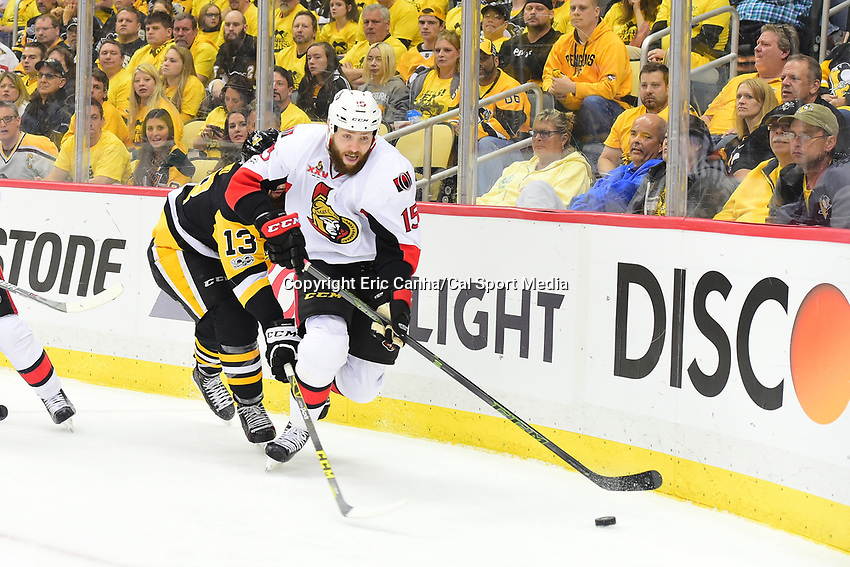 May 15, 2017: Ottawa Senators center Zack Smith (15) beats Pittsburgh Penguins center Nick Bonino (13) for the puck during game two of the National Hockey League Eastern Conference Finals between the Ottawa Senators and the Pittsburgh Penguins, held at PPG Paints Arena, in Pittsburgh, PA. Pittsburgh defeats Ottawa 1-0 in regulation to tie the series 1-1. Eric Canha/CSM