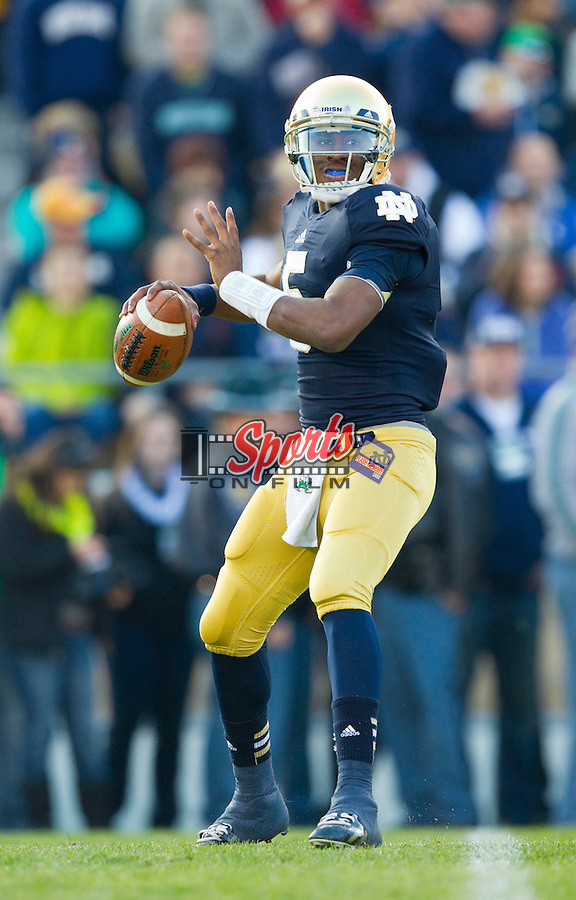 Notre Dame Fighting Irish quarterback Everett Golson (5) looks to pass the ball during first quarter action against the Wake Forest Demon Deacons at Notre Dame Stadium on November 17, 2012 in South Bend, Indiana.  The Fighting Irish defeated the Demon Deacons 38-0.  (Brian Westerholt/Sports On Film)
