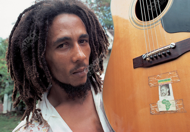 Bob Marley with his guitar, decorated with a picture of Haile Selassie at his home, Tuff Gong, Kingston, Jamaica, March 1976.