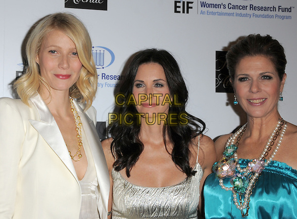 "GWYNETH PALTROW, COURTENEY COX ARQUETTE & RITA WILSON.The Saks Fifth Avenue's ""Unforgettable Evening"" benefiting EIF's Women's Cancer Research Fund held at The Beverly Wilshire Hotel in Beverly Hills, California, USA..February 10th, 2009                                                                     headshot portrait white silk satin gold necklace silver silk satin blue turquoise pearl necklaces halterneck .CAP/DVS.©Debbie VanStory/Capital Pictures."