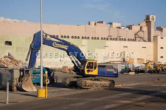 A Cleveland Wrecking Company excavator being used for demolition of Bay Meadows Race Track. The demolition of the racing track facilities took place from September to October 2008. The horse racing track was demolished to make way for a large mixed use development including office space, residential units, retail space, and public parks. The site is located right next to the Hillsdale Caltrain station making it a perfect location for a transit oriented development (TOD) project. San Mateo, California, USA