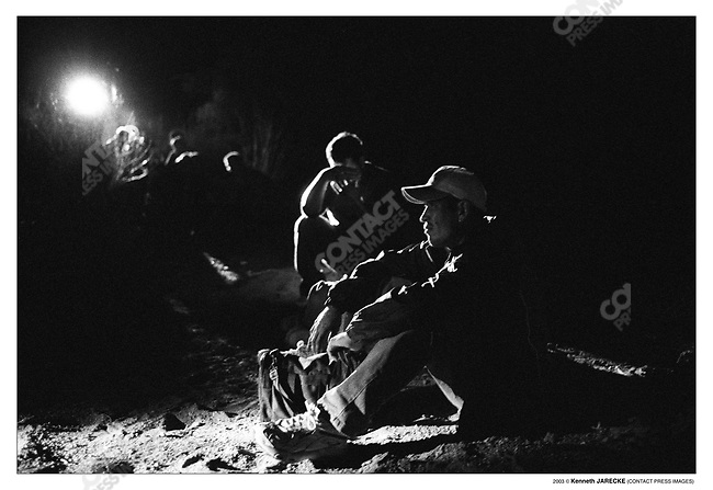 Group of illegal aliens held by members of Civil Homeland Defense, waiting for the U.S. Border Patrol to pick them up. Cochise County, Arizona, July 6,  2003.