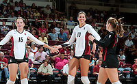 STANFORD, CA - September 2, 2010: Alix Klineman (10) celebrates with Karissa Cook (15) and Gabi Ailes (9) during a volleyball match against UC Irvine in Stanford, California. Stanford won 3-0.
