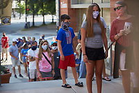 Fans wear face coverings in compliance with the State of North Carolina order prior to entering stadium to watch the Southern Collegiate Baseball League game between the Concord Athletics and the Piedmont Pride at Truist Field on July 3, 2020 in Charlotte, NC. (Brian Westerholt/Four Seam Images)