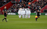 Pictured: Swansea players huddle before kick off Sunday 01 February 2015<br />