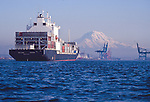 Container ship, Mount Rainier, Tacoma, Commencement Bay, Puget Sound, Washington State. Pacific Northwest, West Coast, USA, Maersk Sea-Land owned Sea-Land Kodiak in 2000. Now sailing as the Horizon Kodiak entering Port of Tacoma