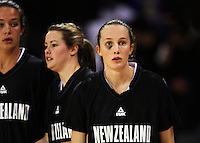 Tall Ferns captain Toni Edmondson (right) with Kim Barnes (left) and Georgina Richards during the International women's basketball match between NZ Tall Ferns and Australian Opals at Te Rauparaha Stadium, Porirua, Wellington, New Zealand on Monday 31 August 2009. Photo: Dave Lintott / lintottphoto.co.nz