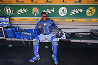 OAKLAND, CA - JUNE 9:  Salvador Perez #13 of the Kansas City Royals gets ready in the dugout before the game against the Oakland Athletics at the Oakland Coliseum on Saturday, June 9, 2018 in Oakland, California. (Photo by Brad Mangin)