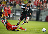 16 April 2011: Toronto FC defender Ty Harden #20 slide tackles D.C. United midfielder/forward Chris Pontius #13 and recieved a red card during an MLS game between D.C. United and the Toronto FC at BMO Field in Toronto, Ontario Canada..D.C. United won 3-0.