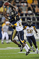 26 September 2009:  FIU tight end Dudley LaPorte (17) attempts to haul in a Paul McCall pass as Toledo cornerback Daxton Swanson (5) defends in the first quarter of the Toledo 41-31 victory over FIU at FIU Stadium in Miami, Florida.