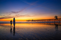 Long Board Surfer Silhouette at Sunset