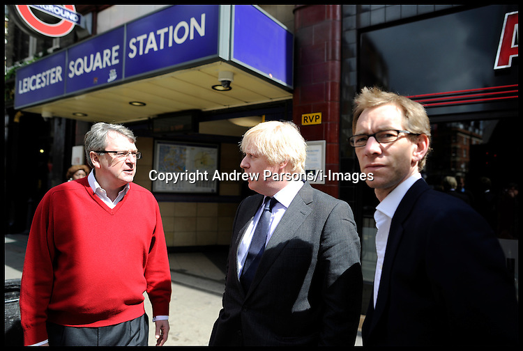 London Mayor Boris Johnson outside Leicester Sq Tube Station with Lynton Crosby and Sam Lyon before going on a walkabout in Chinatown, Sunday April 22, 2012. Photo By Andrew Parsons/I-images