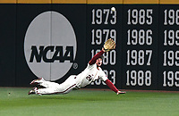NWA Democrat-Gazette/J.T. WAMPLER  Arkansas' Dominic Fletcher makes a diving catch in the top of the seventh inning against Texas Tuesday March 13, 2018 at Baum Stadium in Fayetteville. The Razorbacks beat the Longhorns 13-4.