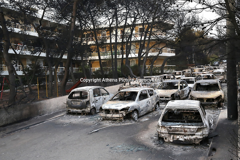 Pictured: Dozens of burned cars in the Mati area, Kokkino Limanaki near Rafina, Greece. Tuesday 24 July 2018<br /> Re: Deaths caused by wild forest fires throughout Greece.