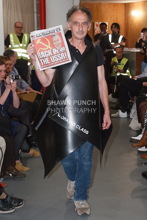 """Model walks runway in an outfit from the """"Comme Des Marxists"""" collection by artist Rainer Ganahl for his fashion show at White Columns art gallery during PERFORMA 13, on November 4, 2013."""