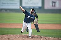 Helena Brewers relief pitcher Roberto Delgado (43) delivers a pitch in front of umpire Patrick Faerber during a Pioneer League game against the Grand Junction Rockies at Kindrick Legion Field on August 19, 2018 in Helena, Montana. The Grand Junction Rockies defeated the Helena Brewers by a score of 6-1. (Zachary Lucy/Four Seam Images)