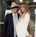 """Dwight Yoakam, Emily Joyce 040 attends the Premiere Of Sony Pictures Classic's """"David Crosby: Remember My Name"""" at Linwood Dunn Theater on July 18, 2019 in Los Angeles, California."""