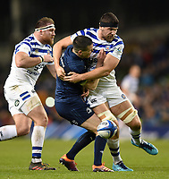 Johnny Sexton of Leinster Rugby has the ball dislodged after a tackle from Charlie Ewels of Bath Rugby. Heineken Champions Cup match, between Leinster Rugby and Bath Rugby on December 15, 2018 at the Aviva Stadium in Dublin, Republic of Ireland. Photo by: Patrick Khachfe / Onside Images