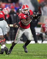 ATHENS, GA - OCTOBER 19: D'Andre Swift #7 of the Georgia Bulldogs makes a run during a game between University of Kentucky Wildcats and University of Georgia Bulldogs at Sanford Stadium on October 19, 2019 in Athens, Georgia.