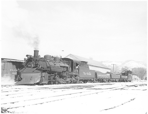 3/4 fireman side view of K-36 #484 with plow at Chama<br /> D&amp;RGW  Chama, NM  Taken by Richardson, Robert W. - 3/1958